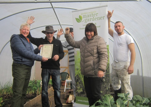 Barry Stone at John Room House's polytunnel.